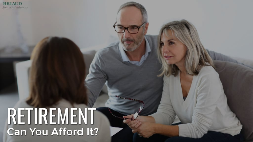 photo shows a couple talking with a financial advisor about savings for retirement